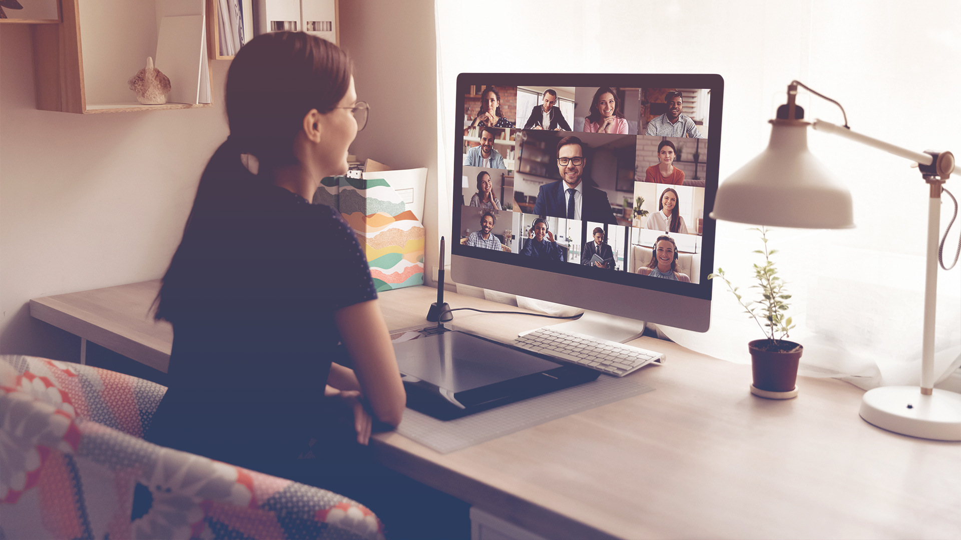 Woman working remotely video call with team